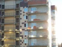 27 декабря корпус 4: кирпич на балконах